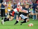 Deon van Rensburg tackles Patrick Lambie